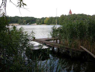 one of the three lakes in Lubniewice. boats, sandy beach and castle.